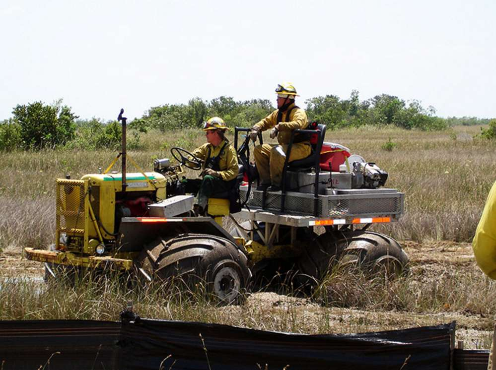 Everglades National Park, Fla., 2009 — Traditional or locally used machinery can be adapted for firefighting. (NPS/Brodeur photo)