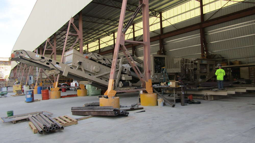 Modifications are made to a KPI-JCI screening plant in the fabrication shop at Goodfellow headquarters in Boulder City, Nev.