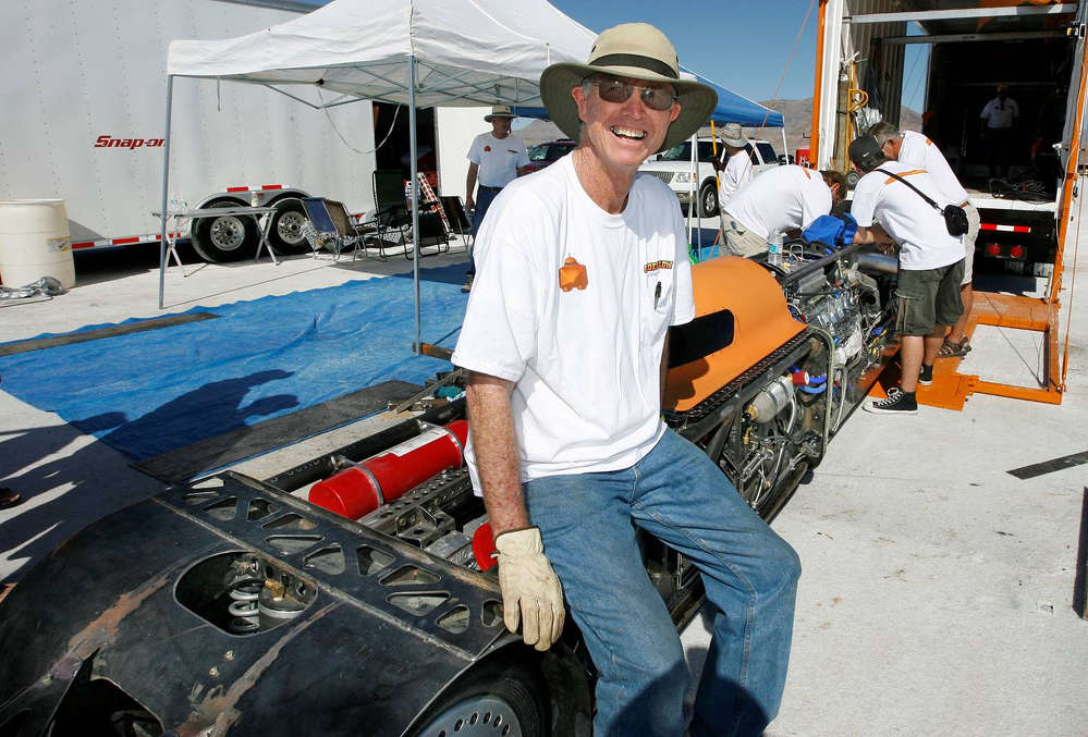 Lynn Goodfellow sits in front of the car in 2008, the first year it was raced. The car was not quite finished.