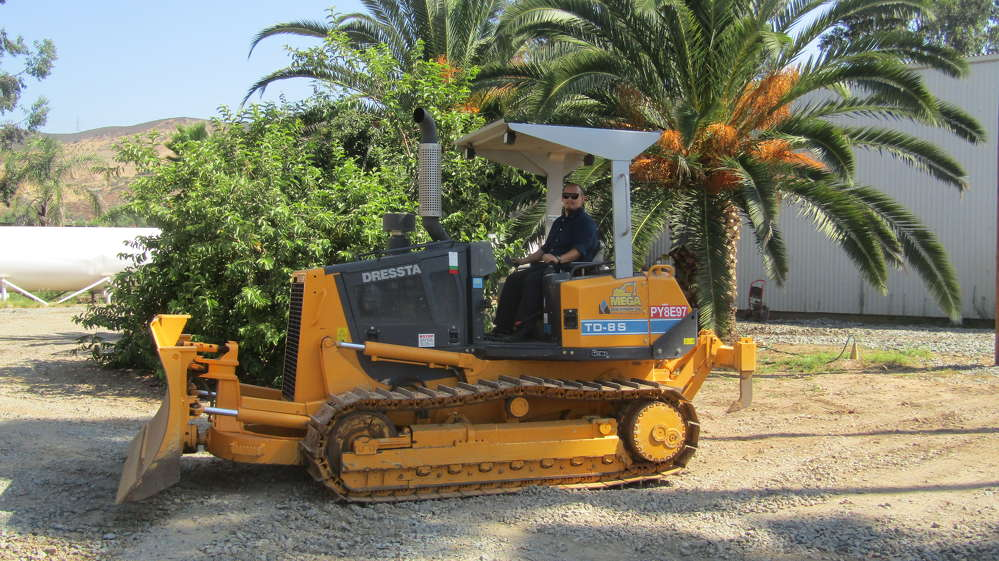 Alex Olsen operates the Tier IV Final Dressta TD-8S at Mega Machinery in Lakeside, Calif.