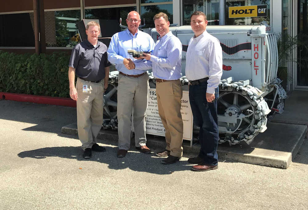 Distribution manager Nayles Bakke from Metso presents the new distribution partner HOLT with a model of a Lokotrack mini crusher. From left: Buck Pate, technical services manager at HOLT; Nayles Bakke, Metso; Evan Creson, VP, Machine Sales South at HOLT; J.K. Baxter Senior, VP, Machine Sales at HOLT.