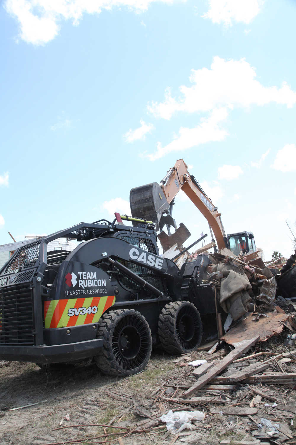 Initial heavy equipment operations included debris removal and home demolition near Rockport and Aransas Pass, Texas, where the eye of Hurricane Harvey made landfall in August. (Photo Credit: Case Construction Equipment and Matt Mateiescu, Team Rubicon)