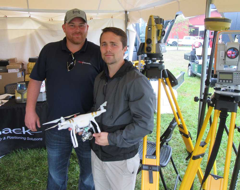GeoShack's Nick Baker (L) and Joe Douglas, imaging and UAV specialist, stand ready to talk about latest advances in laser and GPS technologies.