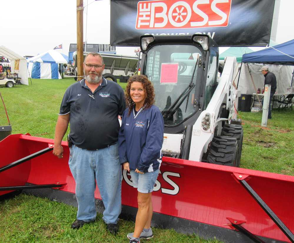 Ron Fiste (L) and Hallie Fourman, both of Mr. Plow Snow & Truck Equipment, showcase a full lineup of snow plows and salt spreaders from Boss and other manufacturers at the show.