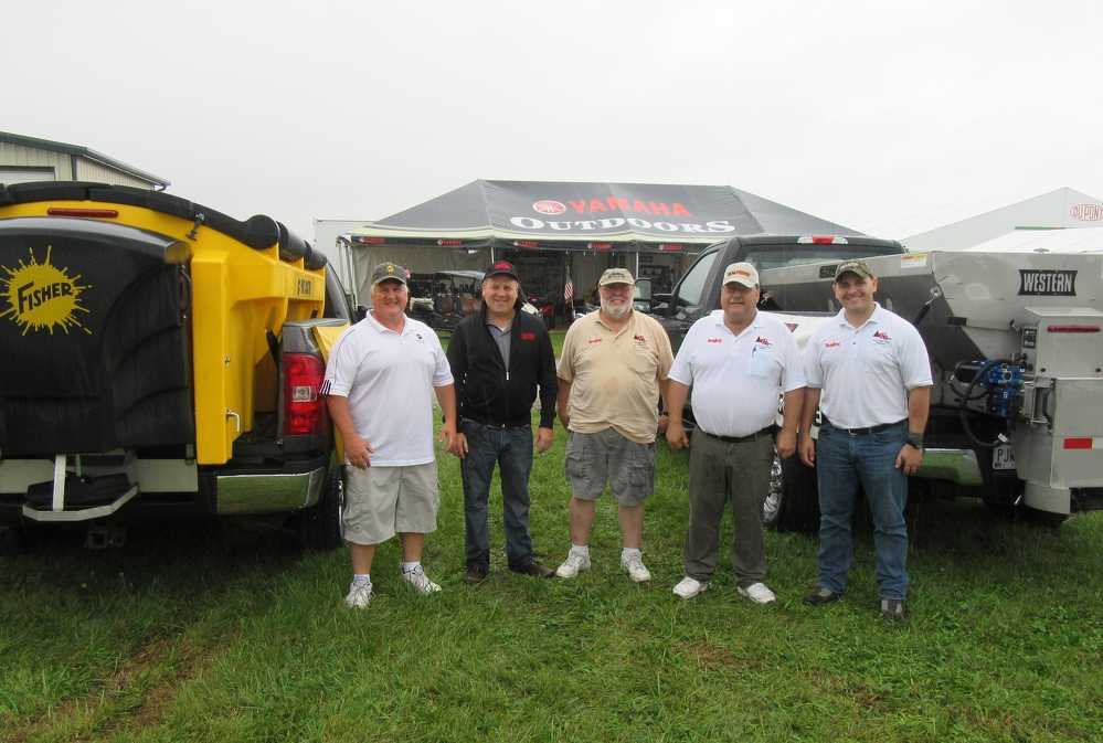 Douglas Dynamics was well represented at KE Rose Company's equipment display. (L-R): Norm Klimko, Fisher Engineering; Rick Passiatore, Western Products; and Larry Barnes, Erich Rose and Cory Walters, all of KE Rose Company, discuss the company's  range of truck equipment.
