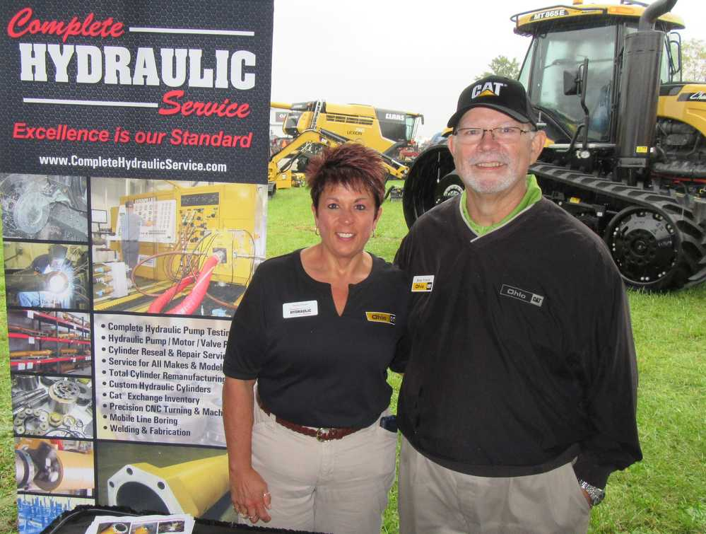 Janie Hovan (L) of Complete Hydraulic Services teams up with Bob Friend, Ohio Cat, to talk about the company's equipment and services.