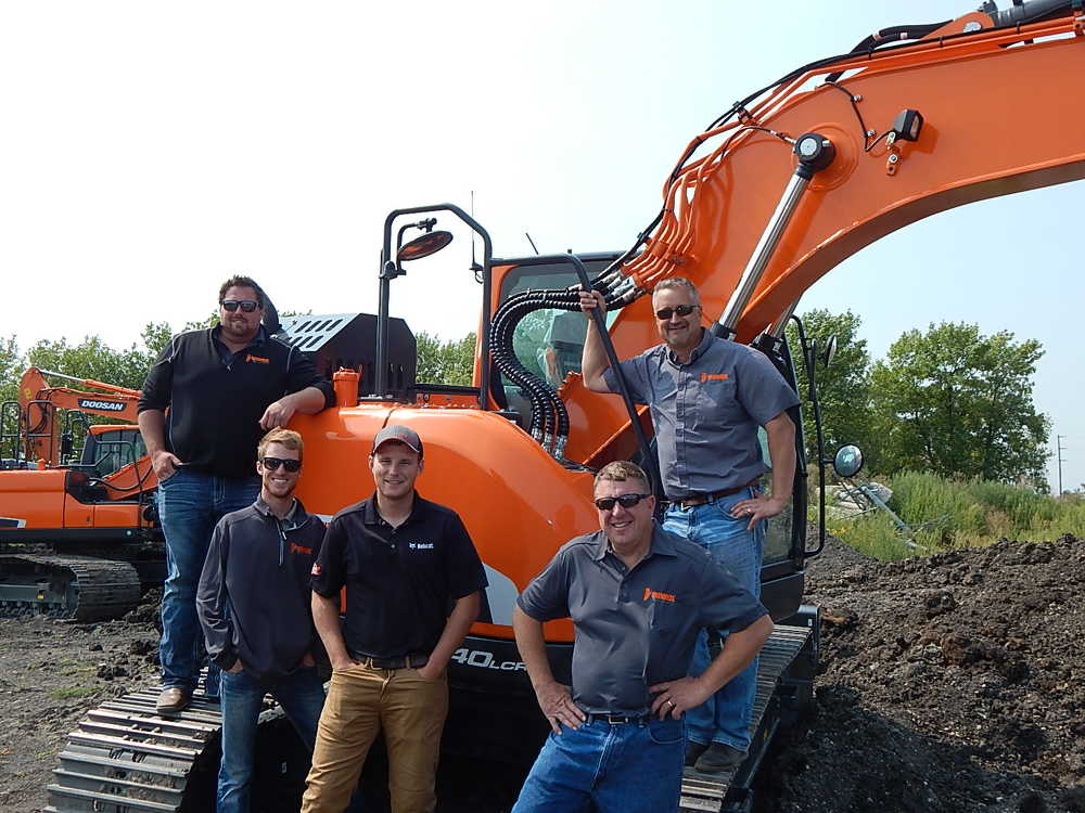 (L-R) are Chris Landis, sales; Sawyer Hanson, marketing; Chuck Regan, sales; Jason Vasichek, president; and Travis Johnson, sales manager, all of Ironhide Equipment.