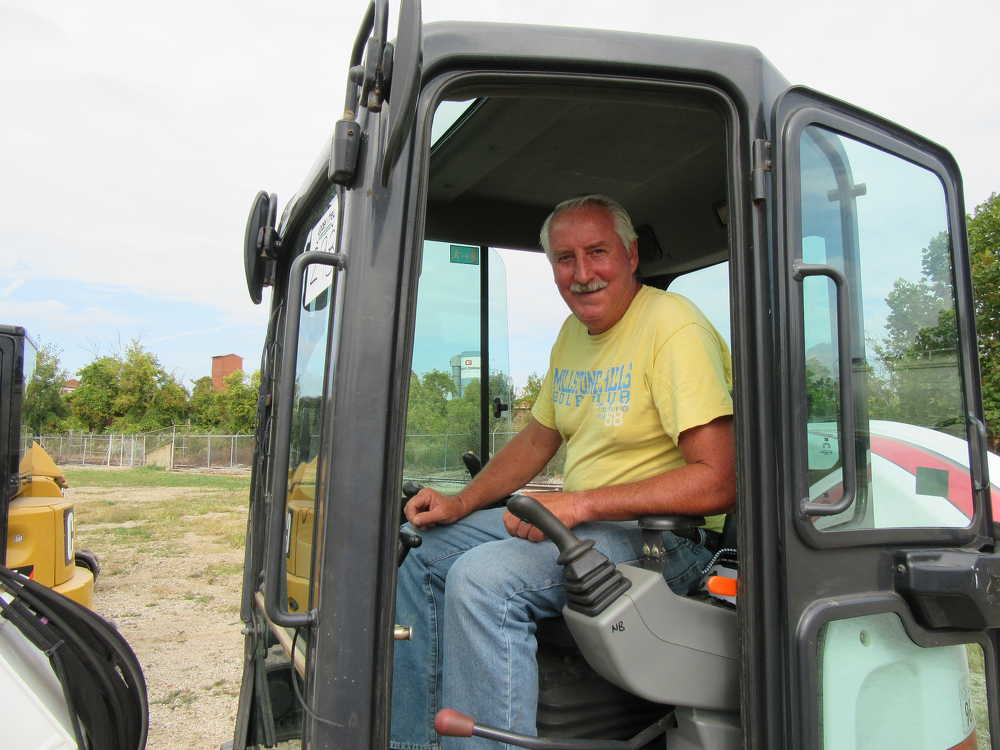Stu Cooke of Cooke Excavating in New London, Ohio, considers a bid on this Bobcat E50 mini-excavator