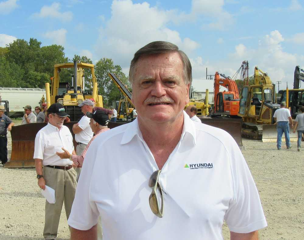 Al Springer of Highway Equipment Company stops in to take in the auction activities and catch up with area contractors.