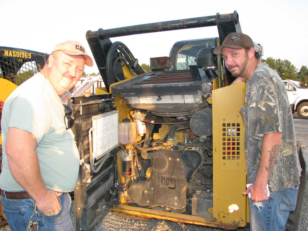 Joe (L) and Jason Wheat, Wheat Properties, Chattsworth, Ga., open up this Cat 299D compact track loader.