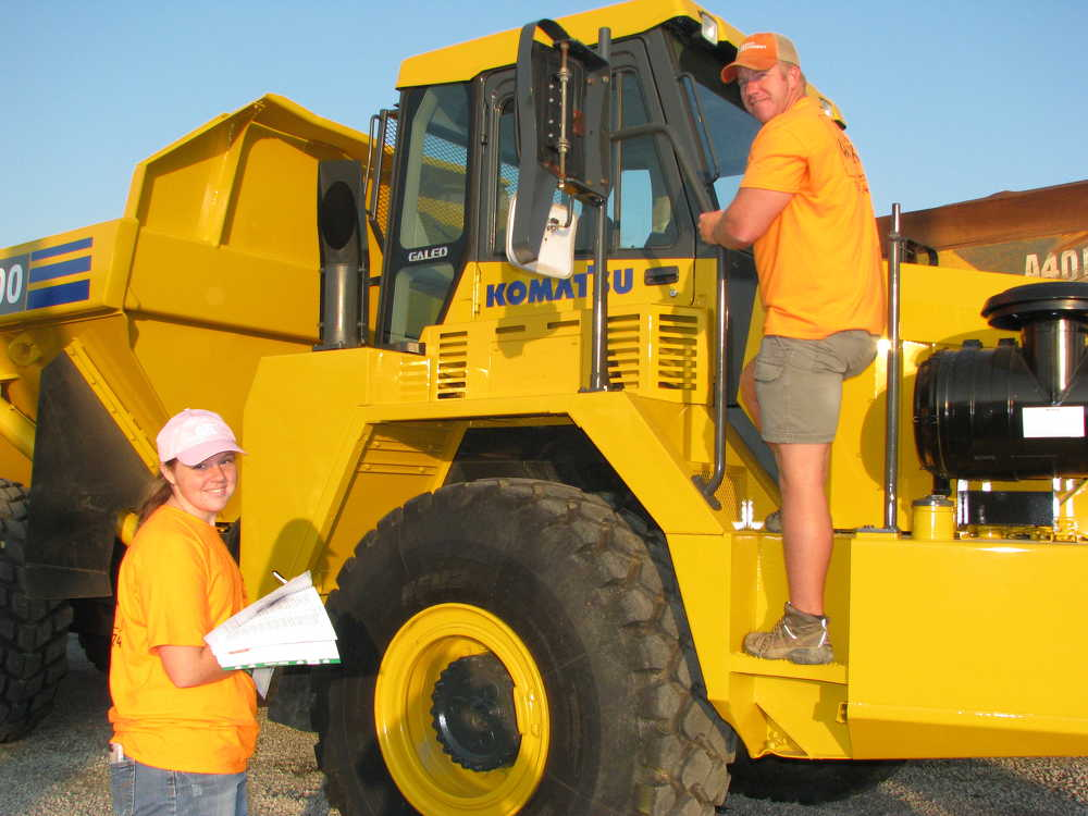 Emilee (L) and her dad, Mark Hale, DirtWorks LLC based in McMinnville, Tenn., came to look at equipment, including this Komatsu HM300 articulated truck.