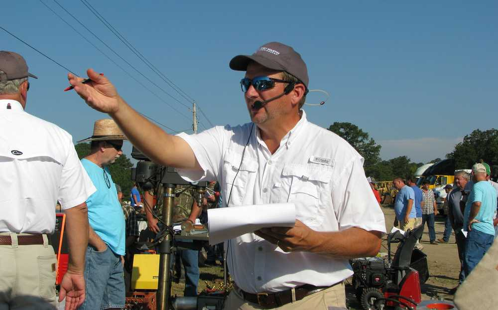 Joey Martin, owner of Joey Martin Auctioneers, works the crowd for more bids.