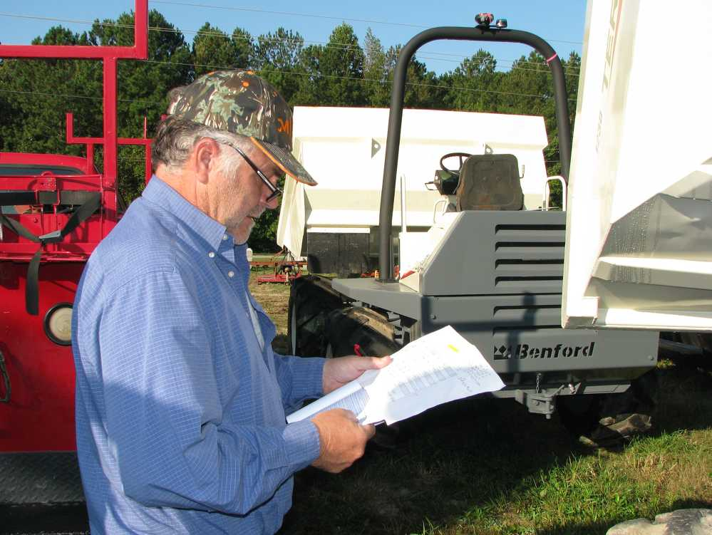 Eugene Nichols of Southland Equipment, Greer, S.C., studies up on a pair of Terex 6-ton site dumpers of interest.