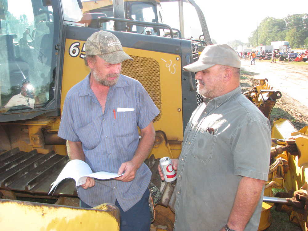 Independent contractors, Kelly Cochran (L), Muscadine, Ala., and Ricky White, Ricky White Construction, Carrollton, Ga., discuss what they plan to bid on.