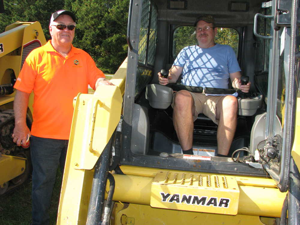 A trio of Yanmar T175 compact track loaders were of specific interest to Benny Hamlin (L), CV Farms, Heflin, Ala., and Darryl Fleming, a farmer based in Oxford, Ala.