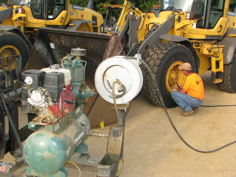 The JM Wood staff works long hours to make sure the machines are all in the best possible condition before they roll across the ramp.