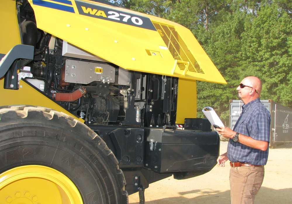Tim Thomas of Tractor & Equipment Co., Birmingham, Ala., considers this Komatsu WA270 wheel loader.