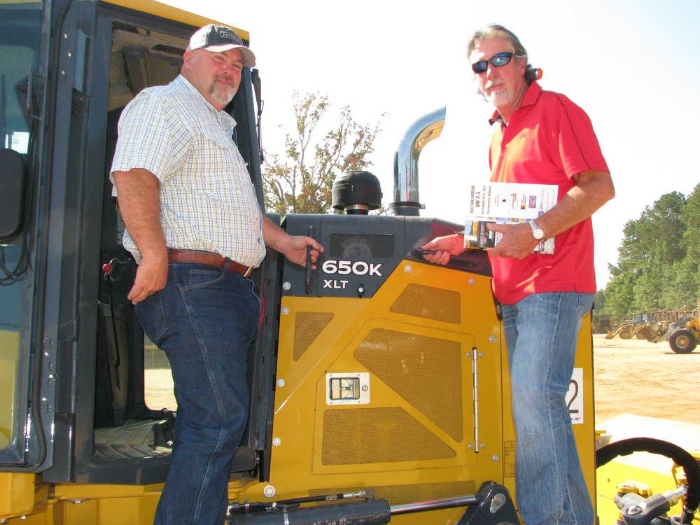 Larry Sherer (L) and Steve Jones, both of Southside Excavating, Jasper, Ala., inspect this John Deere 650K XLT dozer.