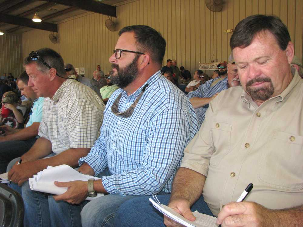 (L-R) are Bill Woods, Woods Equipment, Nashville, Tenn.; George Massey, JM Wood Auction Company; and Tim Irvin, also of JM Wood Auction Company.