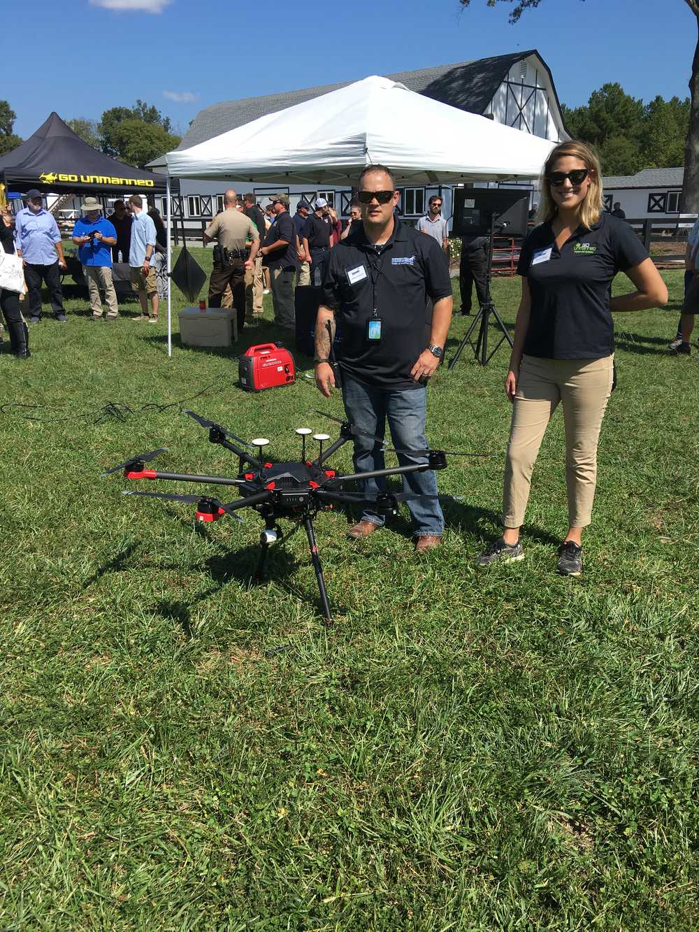 Mike Amann, Go Unmanned sales representative, and Maria Kolar, Go Unmanned marketing manager, pose with the modified Matrice 600 hexacopter.