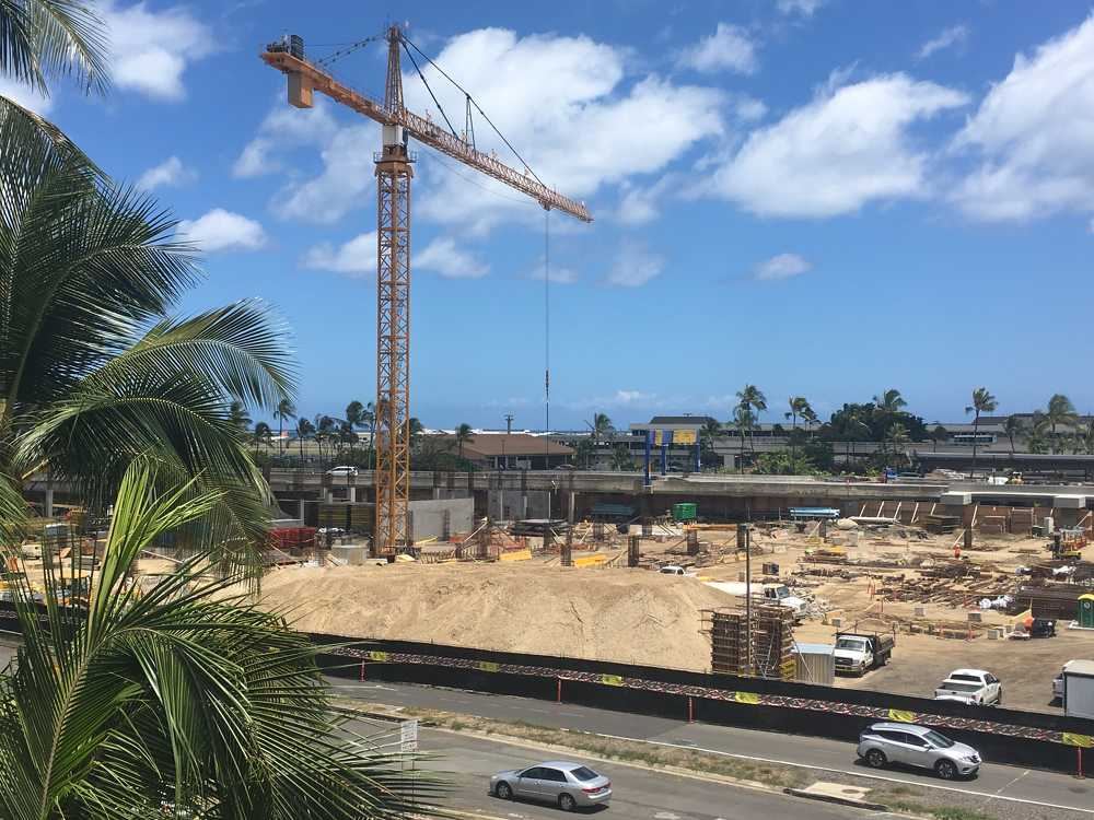 Much of the work on the tall structure is being handled by large cranes.