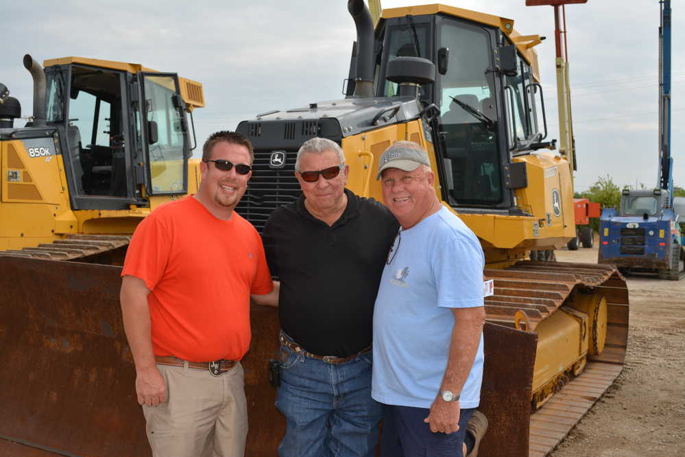 The Wilkins family was out in force at the Lyon auction in Fort Worth. (L-R): Jeremy, Roger and Dale Wilkins of Wilkins Backhoe check out a John Deere 750K dozer. The contractors are located in Ardmore, Okla.