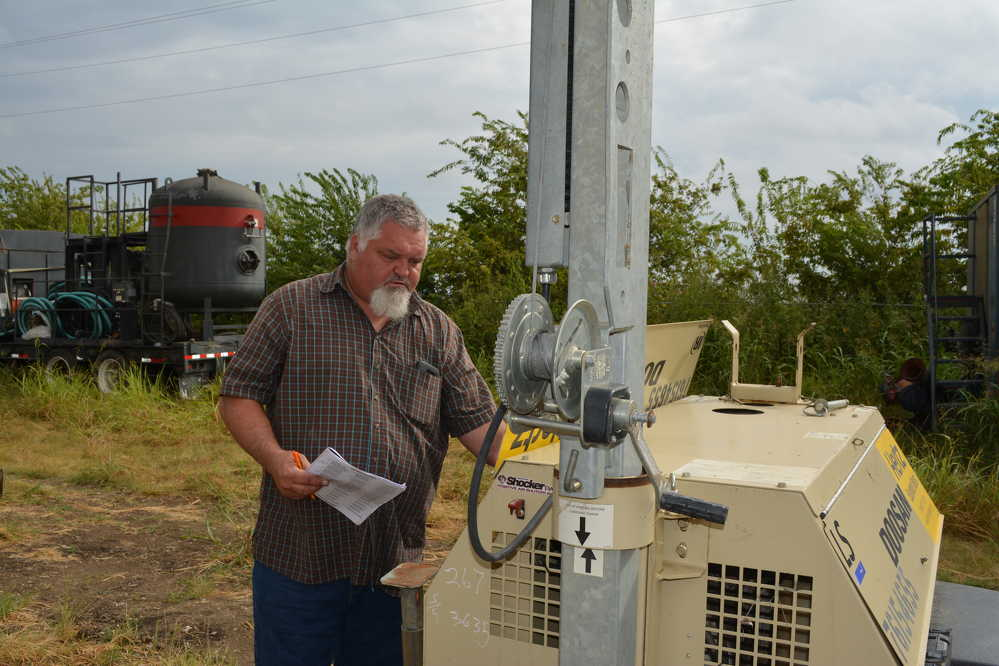 Shane Covey of Barry Burgess Equipment of Kemp, Okla., inspects a Doosan light tower that would later go up for sale.