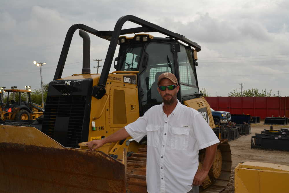 Alex Lyon and Son yard man Brad Collier was a busy man in the hours leading up to the auction, but took time to pose in front of this Cat D6 dozer.