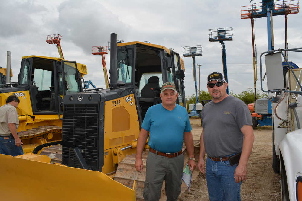Friendly competition: Gary Woodard (L) of GW's Equipment Sales and Robbie Alberson of Robbie's Equipment are both dealers from the Widener, Ark., area who were on hand for the auction.