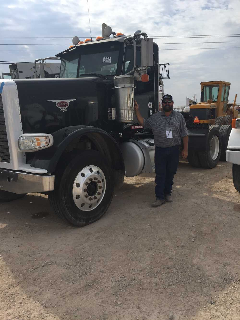 Frank Rempel, of Seminole, Texas, with a 2009 Peterbilt 388 day-cab truck tractor that sold in the Sept. 13 auction.