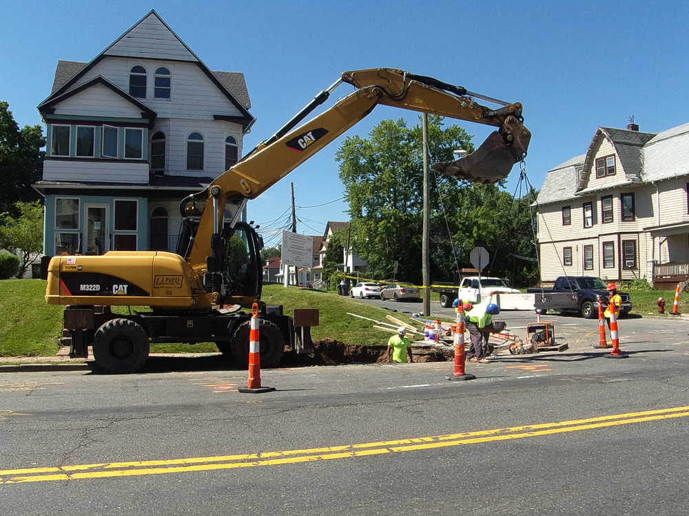 Work includes saw cutting of the existing sidewalks in preparation for removal and reconstruction, as well as reconstruction and installation of drainage catch basins and pipes. (Tectonic photo)