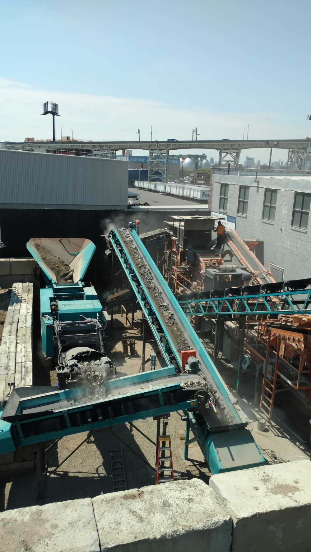 The material is fed into the hopper for processing and then carried via the conveyors.