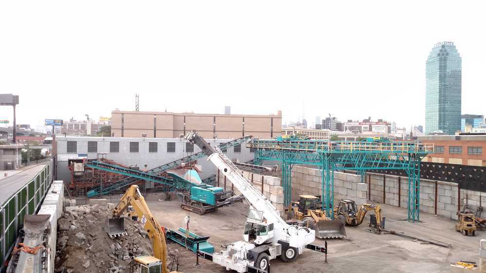 John Patton and the team at Ace Equipment created a custom designed material processing center, that can comfortably fit excavators, loaders, mobile cranes, crushers, impactors and more, all within Hunters Point Recycling's 30,000 sq. ft. lot.