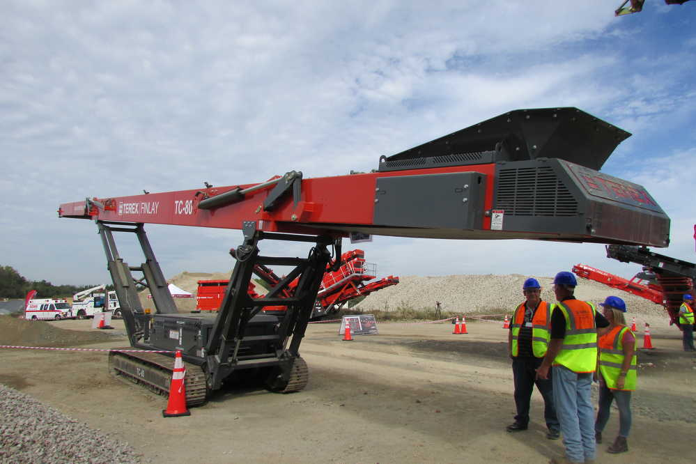 Guests find some shelter from the hot sun under Terex Finlay's new TC-80 conveyor.