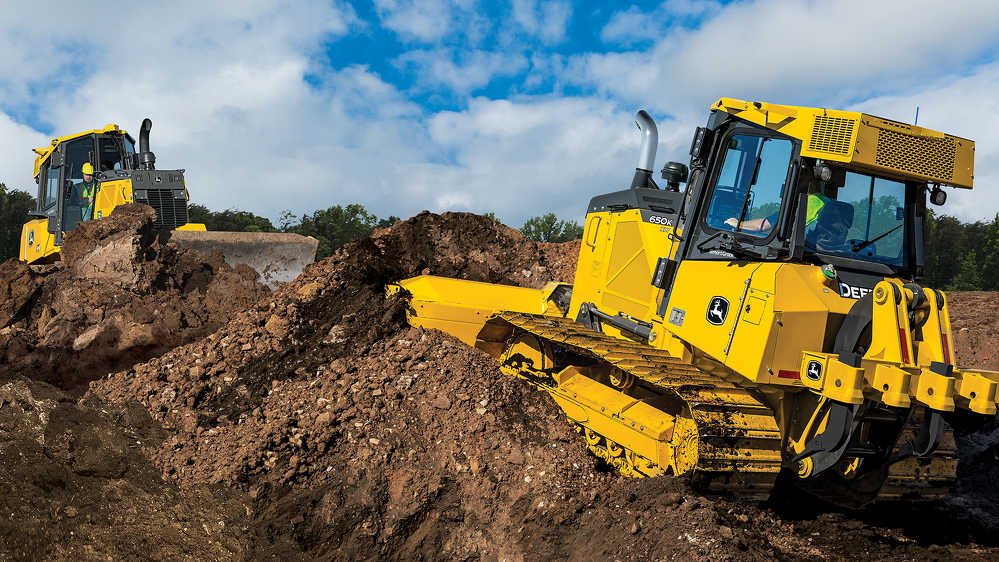 The 650K SmartGrade boasts a 104-horsepower (78 kW) EPA Final Tier 4 John Deere engine. The model's cab-forward designs make visibility, safety and precise grading a priority. Exclusive Total Machine Control comes standard with this model, providing customers with personalization options and optimal comfort.