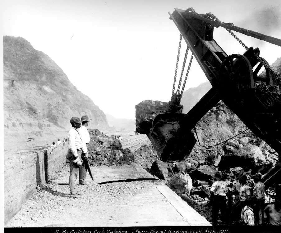 In December 1911, a steam shovel loads rock during the construction of the Panama Canal.