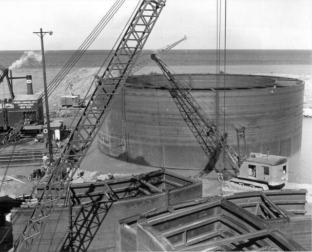 On Aug. 31, 1954, the caisson for the north main tower foundation is afloat at Wiltse Brothers Shipyard near Alpena.