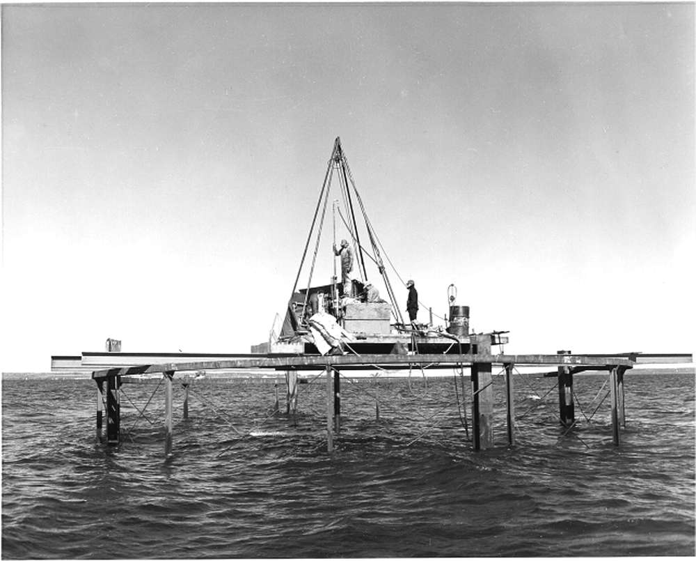 Workers make test borings with a drilling rig for Pier 11 on Oct. 19, 1954.