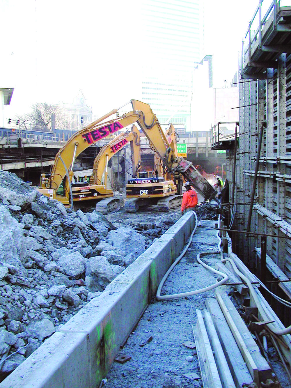 Testa workers clear the way for the underground I-93 north- bound lanes.