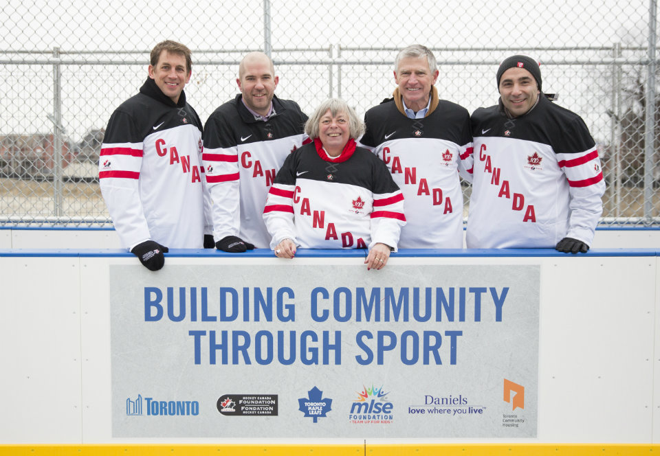 After a community skate, developer The Daniels Corporation, TCHC, Councillor Pam McConnell, the MLSE and Hockey Canada are all smiles at the newly renovated rink in the Regent Park Athletic Grounds. Right to left, Remo Agostino, Vice-President, Development, The Daniels Corporation; Bud Purves, Chair of the Board, TCHC; Pam McConnell, Toronto Deputy Mayor/Councillor Ward 28; Michael Bartlett, Executive Director, MLSE Foundation; Chris Bright, Executive Director, Hockey Canada Foundation. Photo by: MLSE