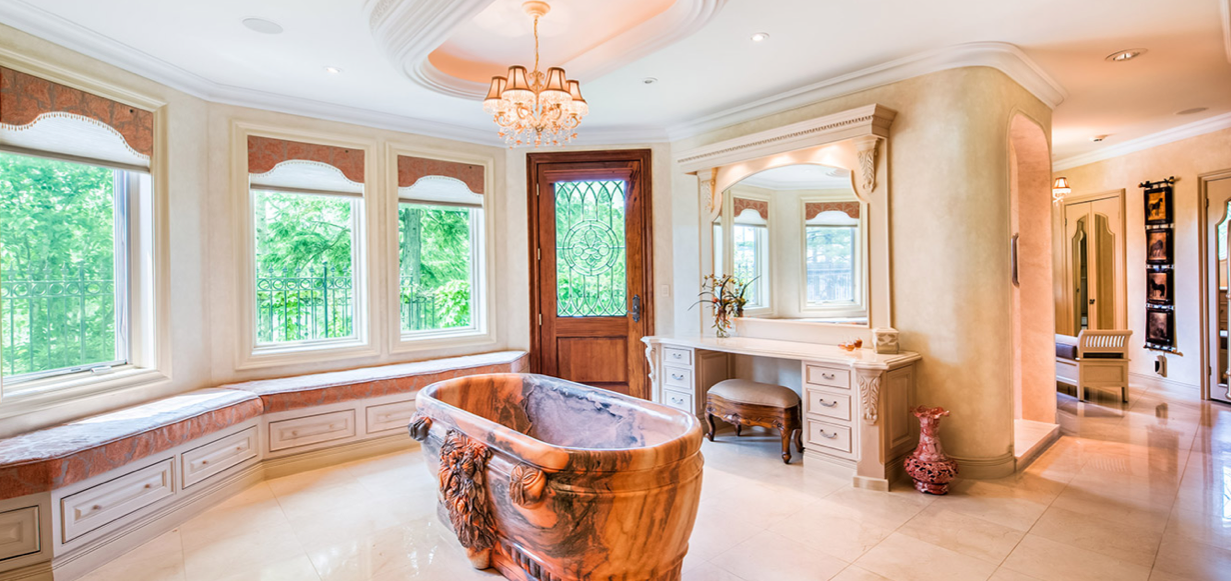 The main residence includes six full baths and five half baths, while the guest house includes two full baths