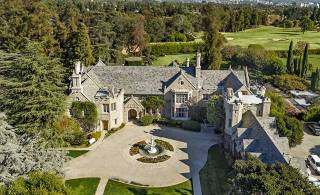 Hefner lists Playboy mansion for $200 million