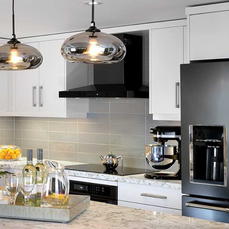 Warm greys and subtle metallics compliment black stainless steel appliances by KitchenAid in this ktichen design by Jamie Alexander and Glen Peloso www.pelosoalexander.com