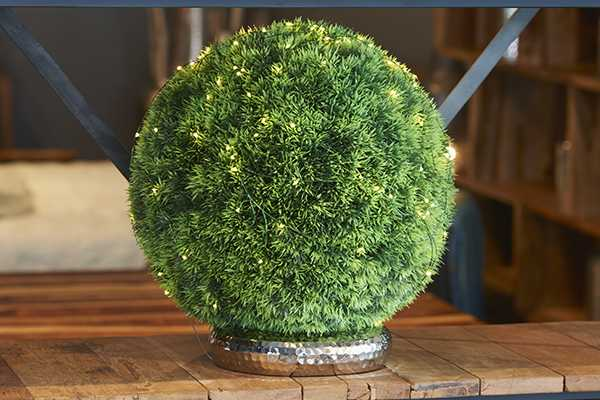 Don't have a green thumb? Fake it with faux greenery from HomeSense, threaded with LED lights.