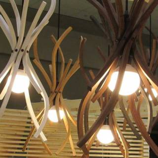 Love these organic, earthy wood chandeliers.