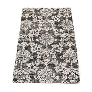 Damask patterned rug (5' by 7'). $200 homesense.ca