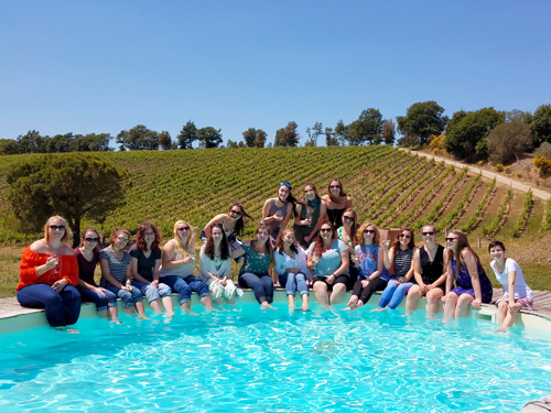 Students in front of vineyard in Italy.