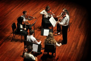 The members of the Seton Strings perform in a Community Music Program recital