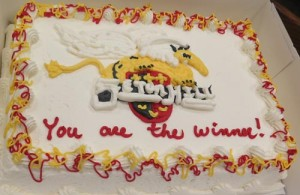 Cake with Griffin and Seton Hill logo in icing on top.