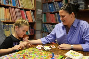 A counselor works with a young child in an educational setting.